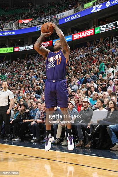 J Tucker of the Phoenix Suns shoots the ball against the Utah Jazz on December 21 2015 at vivintSmartHome Arena in Salt Lake City Utah NOTE TO USER...