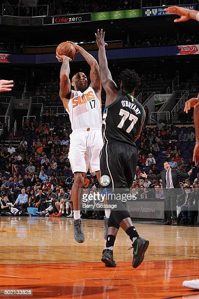 J Tucker of the Phoenix Suns shoots the ball during the game against the Milwaukee Bucks on December 20 2015 at US Airways Center in Phoenix Arizona...
