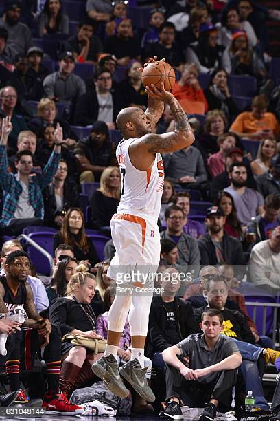 J Tucker of the Phoenix Suns shoots the ball during the game against the Miami Heat on January 3 2017 at Talking Stick Resort Arena in Phoenix...