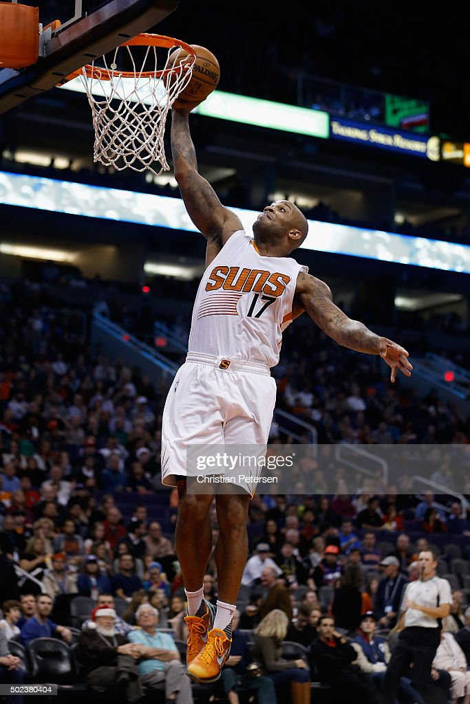 P.J. Tucker #17 of the Phoenix Suns slam dunks the ball against the Denver Nuggets during the second half of the NBA game at Talking Stick Resort Arena on December 23, 2015 in Phoenix, Arizona. The Nuggets defeated the Suns 104-96.
