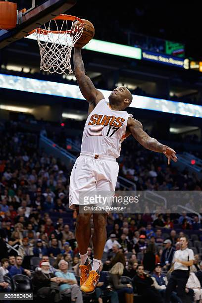 J Tucker of the Phoenix Suns slam dunks the ball against the Denver Nuggets during the second half of the NBA game at Talking Stick Resort Arena on...