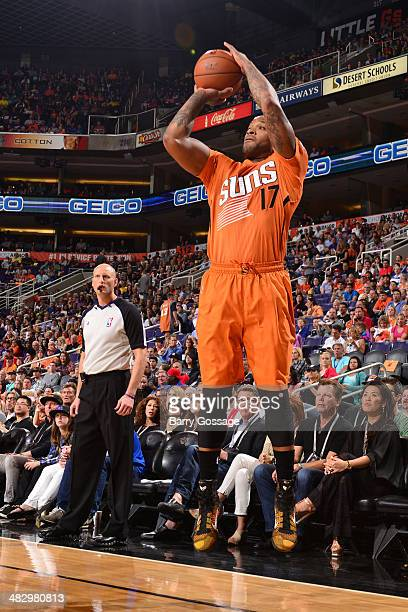 J Tucker of the Phoenix Suns takes a shot against the Detroit Pistons on March 21 2014 at US Airways Center in Phoenix Arizona NOTE TO USER User...