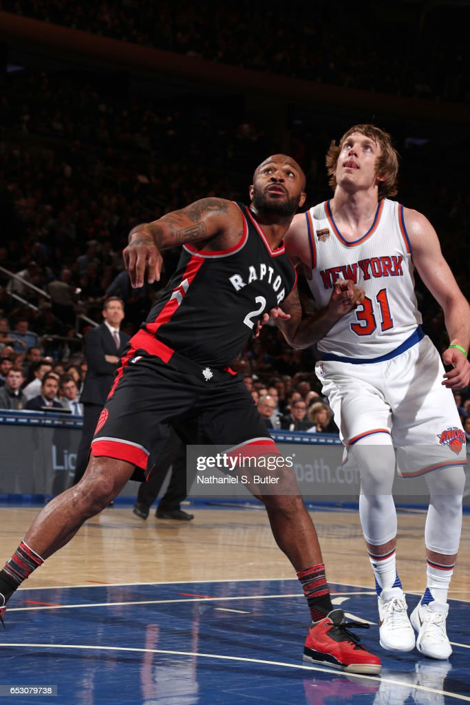 P.J. Tucker #2 of the Toronto Raptors boxes out against Ron Baker #31 of the New York Knicks on February 27, 2017 at Madison Square Garden in New York City.