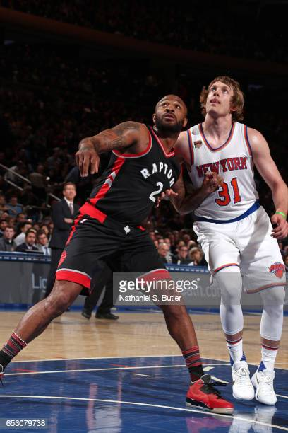 J Tucker of the Toronto Raptors boxes out against Ron Baker of the New York Knicks on February 27 2017 at Madison Square Garden in New York City NOTE...