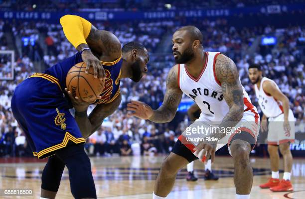 J Tucker of the Toronto Raptors defends as Lebron James of the Cleveland Cavaliers dribbles the ball in the first half of Game Four of the Eastern...