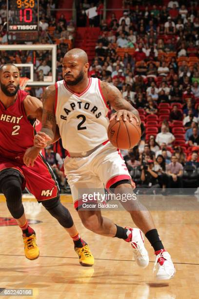 J Tucker of the Toronto Raptors drives to the basket against the Miami Heat on March 11 2017 at AmericanAirlines Arena in Miami Florida NOTE TO USER...