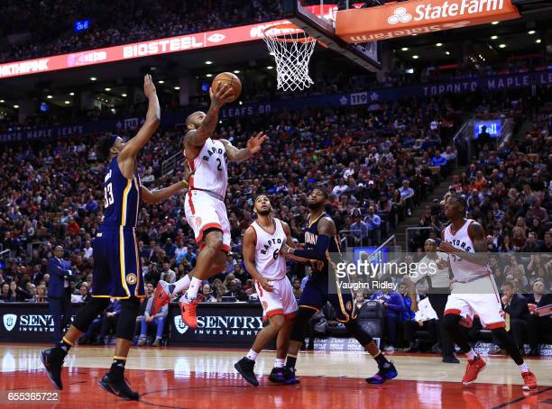 J Tucker of the Toronto Raptors drives to the basket as Myles Turner of the Indiana Pacers defends during the second half of an NBA game at Air...