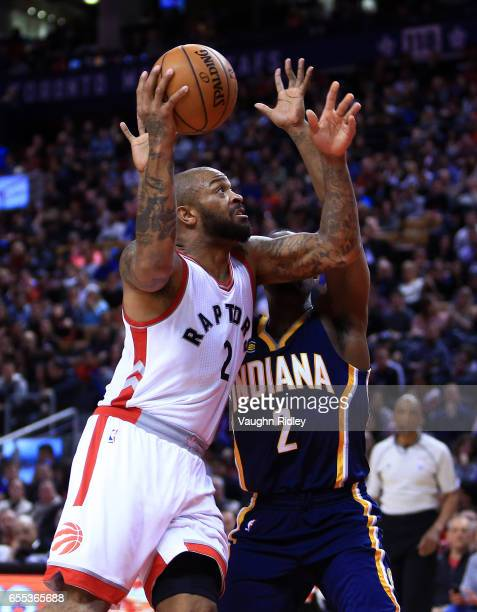 J Tucker of the Toronto Raptors drives to the basket as Rodney Stuckey of the Indiana Pacers defends during the second half of an NBA game at Air...