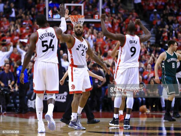 J Tucker of the Toronto Raptors high fives Patrick Patterson and Serge Ibaka in the first half of Game Two of the Eastern Conference Quarterfinals...