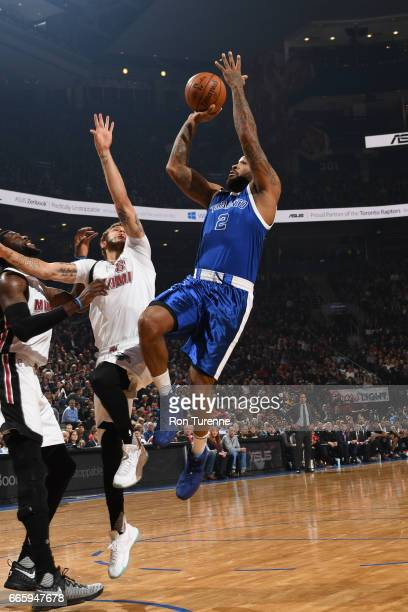 J Tucker of the Toronto Raptors shoots the ball against the Miami Heat on April 7 2017 at the Air Canada Centre in Toronto Ontario Canada NOTE TO...