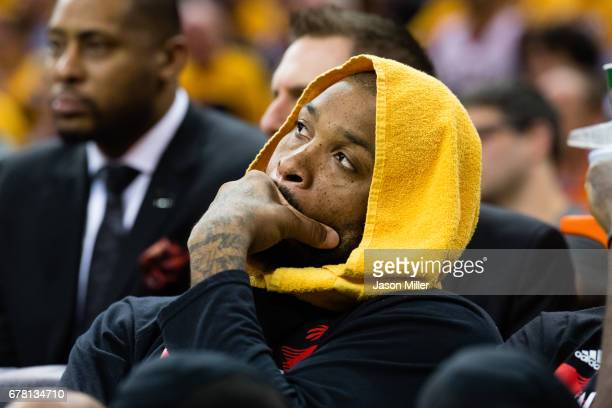 Tucker of the Toronto Raptors watches from the bench during the final minutes of the second half of Game Two of the NBA Eastern Conference semifinals...