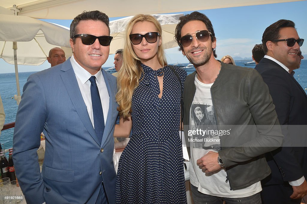 Tucker Tooley Valentina Zelyaeva and Adrian Brody attend the Relativity at 10 party at Hotel du CapEdenRoc on May 18 2014 in Cap d'Antibes France