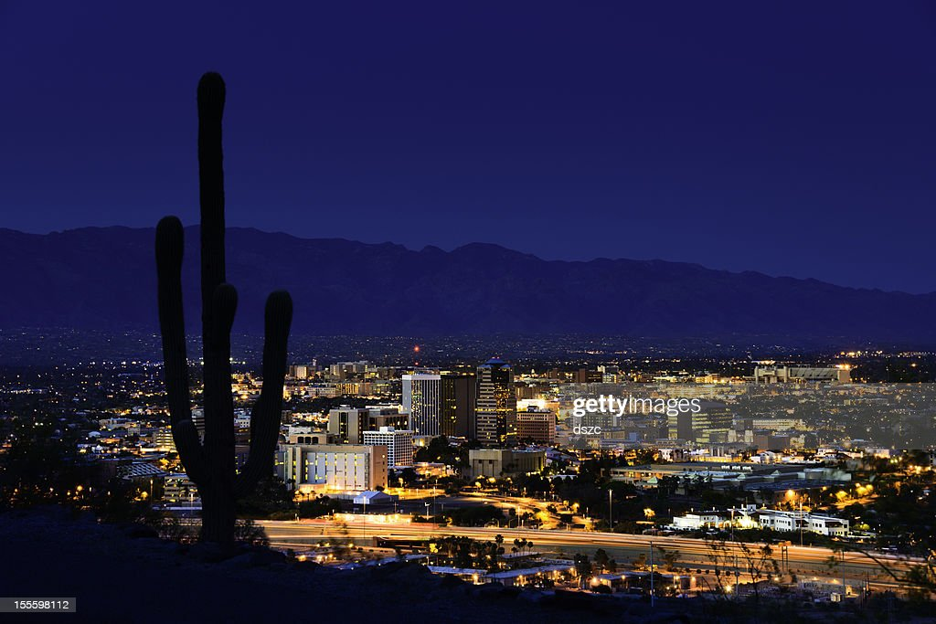 Tucson arizona at night framed by saguaro cactus and for Abstract salon tucson