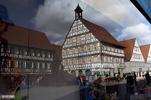 Tudor houses are reflected in a window of a toy store in the city center on March 5 2010 in Winnenden Germany Tim Kretschmer opened fire on teachers...