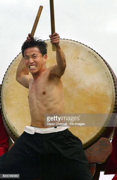 Tuek Hu Ha a traditional Korean Dulsori drummer performs with his 2 metre tall drum as part of his Edinburgh Festival Fringe act on Calton Hill...