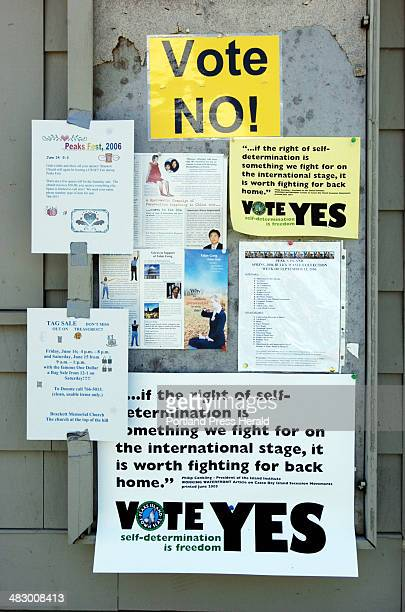 Signs on a bulletin baord by the ferry landing on Peaks Island urge voters to vote yes or no on the secession referendum