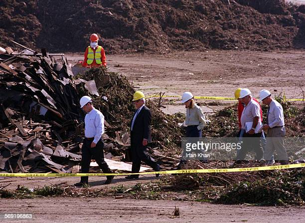 Tuesday morning officials from Cal–OSHA and Taormina Industries recycling company inspecting the green waste processing area where last night a...