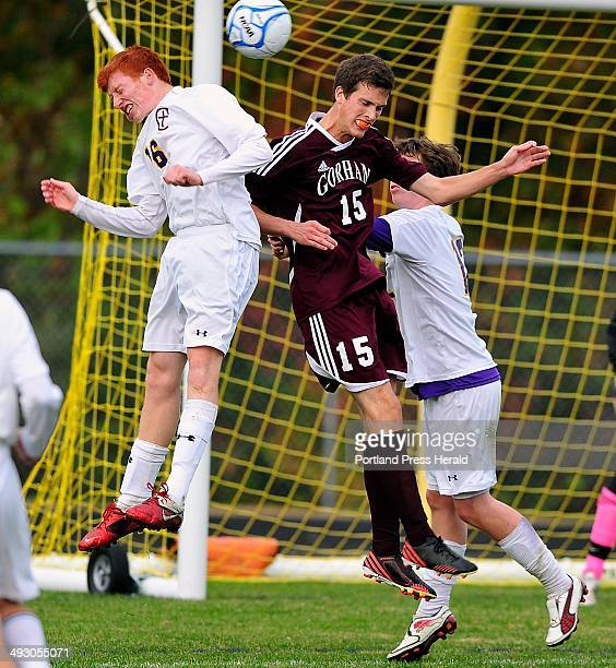 Tuesday October 22 2013 Gorham Austin Bell tries to head the ball into the goal on a corner kick as Cheverus players #16 Zach Poulin and Nate Smith...