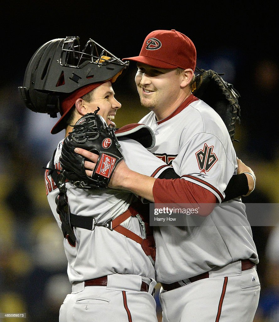 Tuffy Gosewisch #9 and <a gi-track='captionPersonalityLinkClicked' href=/galleries/search?phrase=Trevor+Cahill&family=editorial&specificpeople=5437061 ng-click='$event.stopPropagation()'>Trevor Cahill</a> #35 of the Arizona Diamondbacks celebrate a 4-2 win over the Los Angeles Dodgers in 12 innings at Dodger Stadium on April 18, 2014 in Los Angeles, California.