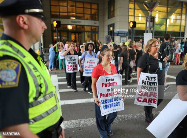 Tufts Medical Center nurses cross Washington Street to join a picket line in front of the hospital as walk off their jobs and begin a strike in...