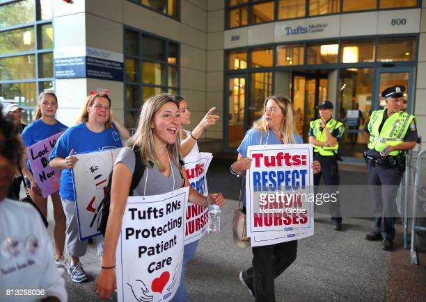 Tufts Medical Center nurses march on Washington Street in a picket line in front of the hospital as they walk off their jobs and begin a strike in...