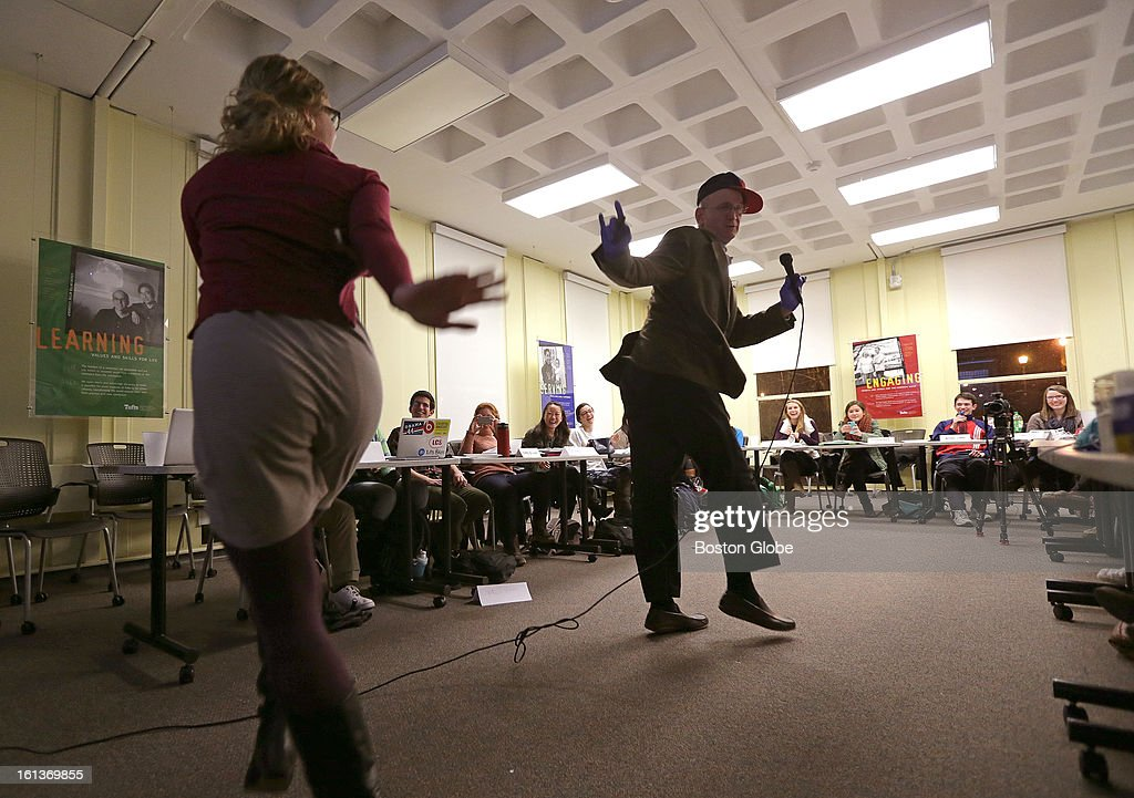 Tufts University professor Jonathan Garlick a.k.a. Dr. Jonny Cool G, is joined in dance by post doctorate scholar Lara Park, at left, as he breaks it down performing rap to teach students about complicated scientific concepts, such as stem cells. Garlick is seen here during a Freshman Anthropology 5 Science and the Human Experience seminar.