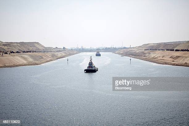 A tug boat makes its way into a section of the New Suez Canal operated by the Suez Canal Authority in Ismailia Egypt on Wednesday Aug 5 2015 The...