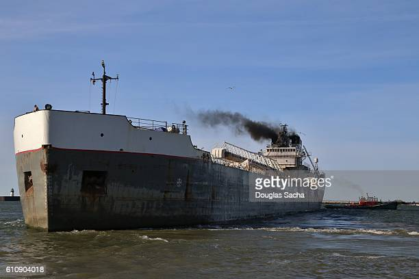 Tug boat pulles a Freight ship into the open water
