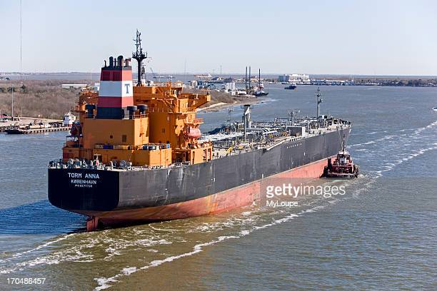 Tug boats and oil tanker leaving Galveston Bay Texas United States navigation and steering in boat channel oil and fuel transportation