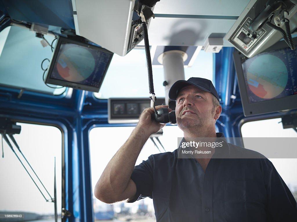 Tug captain speaking on radio
