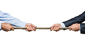 Two businessmen pulling a rope in opposite directions isolated on white background