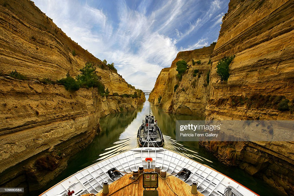 Tug pulling cruise ship through the Corinth Canal