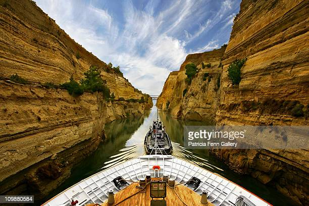 Tug pulling cruise ship through the Corinth Canal