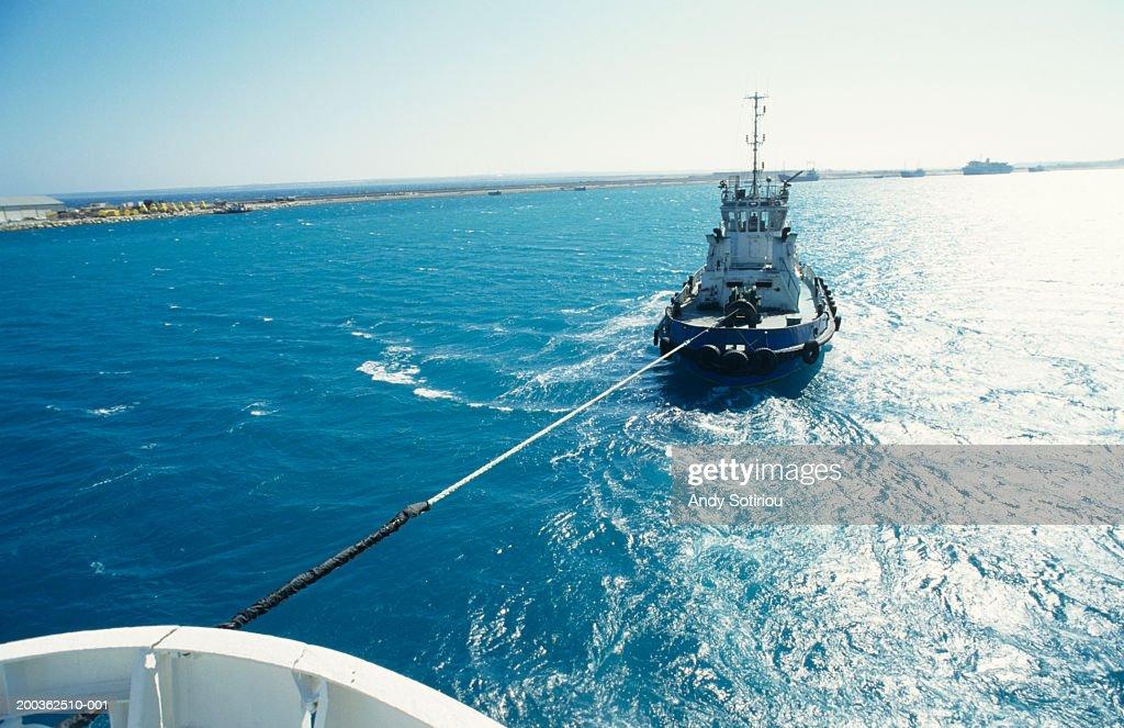 Tug pulling ship, Limassol, Cyprus, elevated view