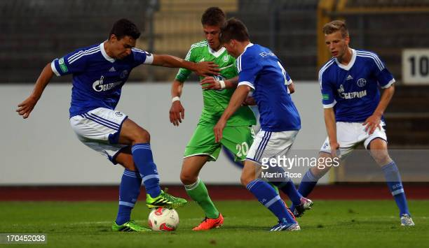 Tugay Uzan of Wolfsburg battles for the ball with Axel Borgmann and Kaan Ayhan of Schalke during the A Juniors Bundesliga first leg semi final match...