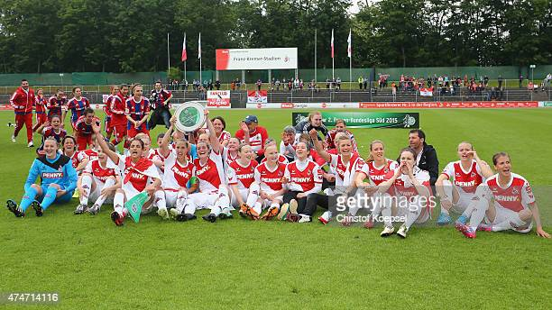 Tugba Tekkal AnnaSophie Fliege and Philine von Bargen of Koeln lift the trophy of the Women's 2nd Bundesliga South after the Women's 2nd Bundesliga...