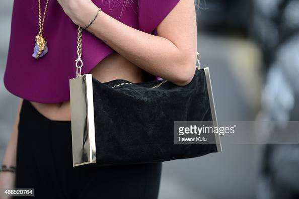 Tugba Tunckaya poses wearing a handbag by Inci and charm of her design by Dianoir during Mercedes Benz Fashion Week Istanbul FW15 on March 16 2015 in...