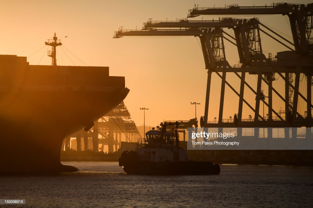 Tugboat and container ship of port of Oakland