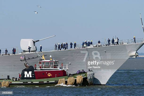 A tugboat helps the destroyer USS Porter leave Naval Station Norfolk September 16 2003 in Norfolk Virginia The Navy ordered 40 ships out to sea as...