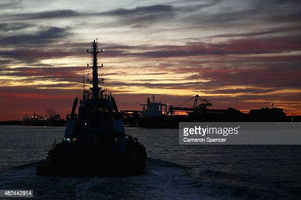 Tugboat Master John Duncan heads to a job with other tugboats to assist a coal ship at Kooragang Island Coal Terminal in Newcastle Port on July 30...