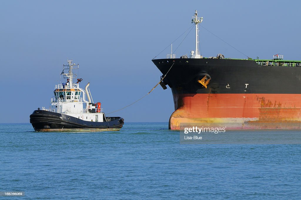Tugboat Pulling Industrial Ship