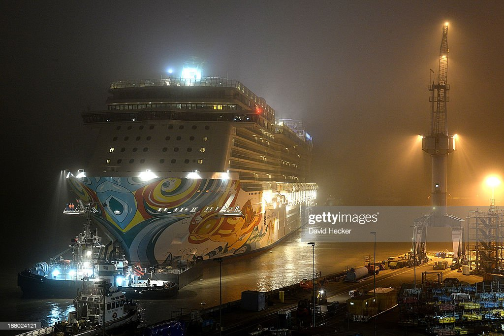 A tugboat pulls the Norwegian Getaway cruise ship down the Ems river towards the North Sea shortly after construction of the ship was finished at the Meyer Werft shipyard on November 15, 2013 near Leer, Germany. The Getaway belongs to the Norwegian Cruise Line, has a capacity of 4,000 passengers and is scheduled to be christened by the cheerleaders of the Miami Dolphins NFL football team in February.