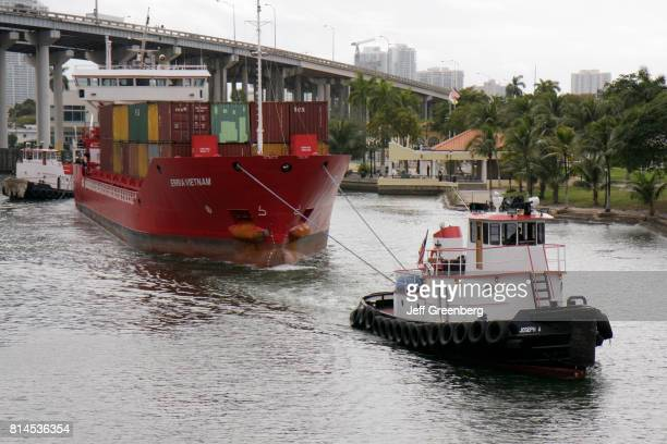 A tugboat towing Erria Vietnam boat on the Miami River