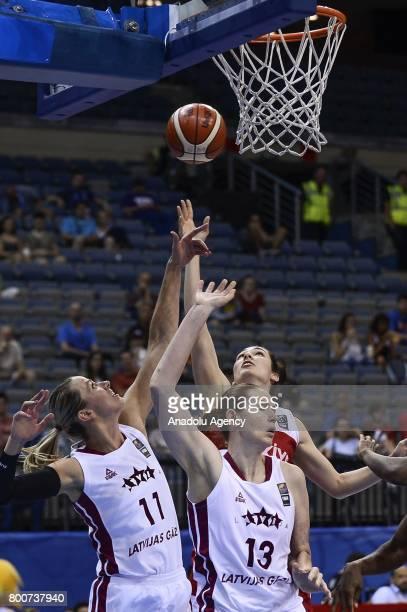 Tugce Canitez of Turkey in action against Alija Brumermane and Aija Putnina of Latvia during the 2017 FIBA EuroBasket Women qualifications 5 to 6...