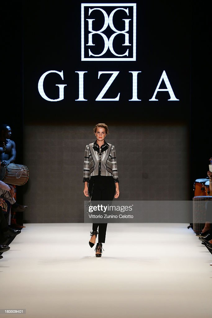 Tugce Kazaz walks the runway at the Gizia show during Mercedes-Benz Fashion Week Istanbul s/s 2014 on October 7, 2013 in Istanbul, Turkey.