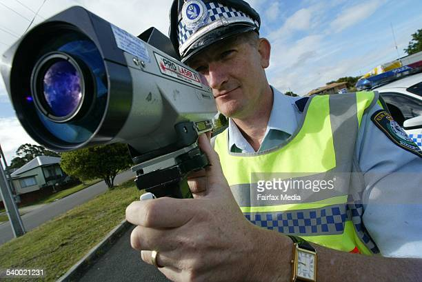 Tuggerah Lakes highway patrol supervisor Gary Carr with a speed camera on the New South Wales 3 September 2003 NCH Picture by RYAN OSLAND