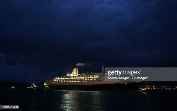 Tugs guide the QE2 as it arrives at the Ocean Terminal on the Firth of Clyde early this morning
