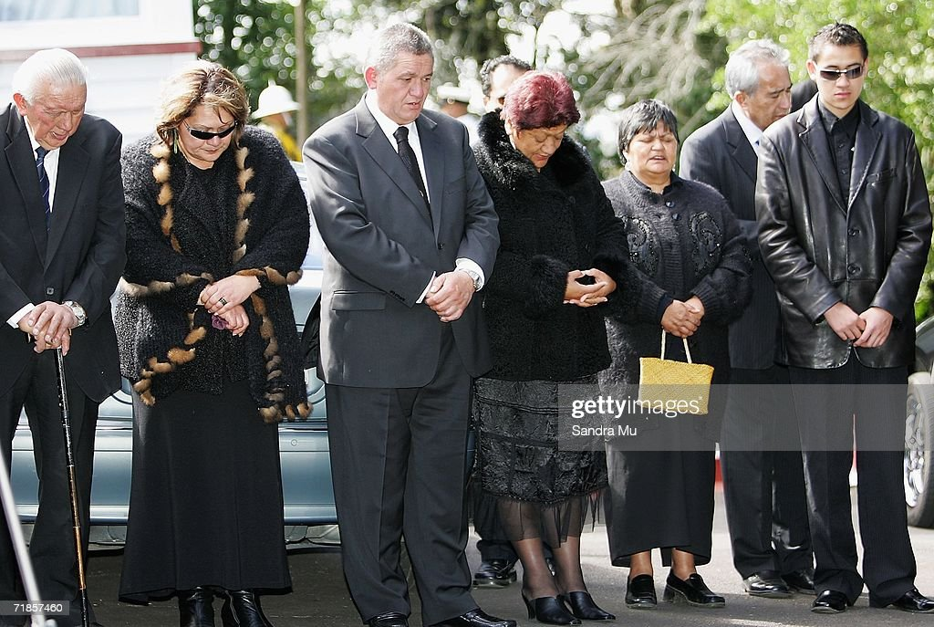 Tuheitia Paki, the Maori King (3rd R) and his wife Te Atawhai (4th R) stand outside the house for a karakia (prayer) after paying their respects to the Late King of Tonga, Taufa'ahau Tupou IV in Epson, September 12, 2006 in Auckland, New Zealand. The body of the Late King will lie in state at his Auckland residence Atalanga before flying back to Tonga tomorrow for a state funeral.