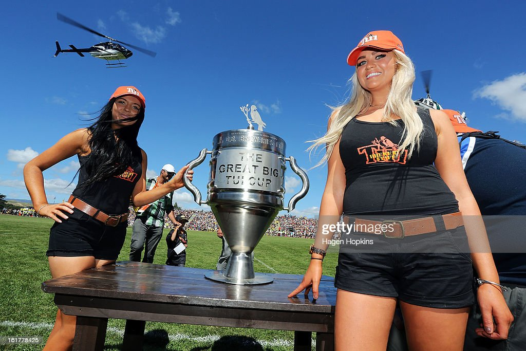 Tui girls pose with the Great Big Tui Cup during the Super Rugby trial match between the Hurricanes and the Chiefs at Mangatainoka RFC on February 16, 2013 in Mangatainoka, New Zealand.