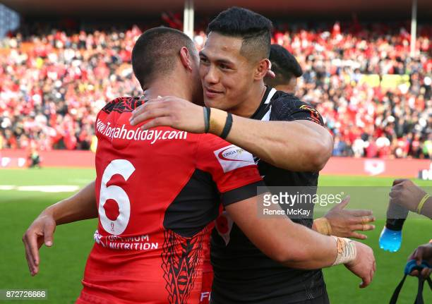 Tuimoala Lolohea and Roger Tuivasa Sheck embrace during the 2017 Rugby League World Cup match between the New Zealand Kiwis and Tonga at Waikato...